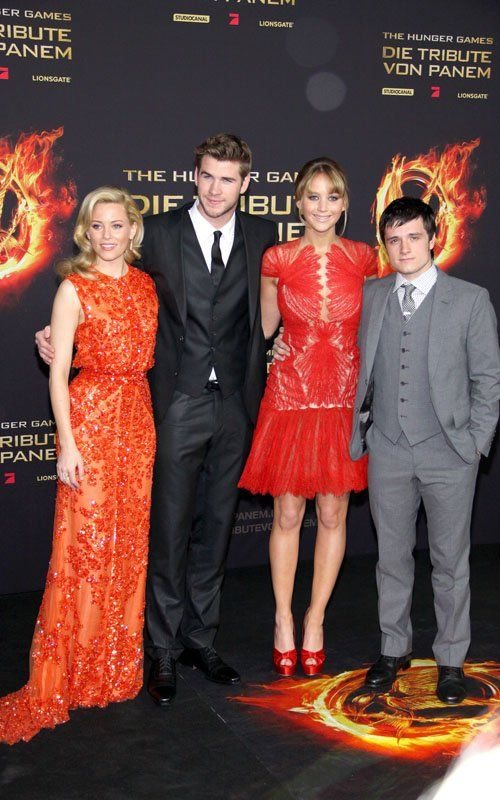Elizabeth Banks, Liam Hemsworth, Jennifer Lawrence, and Josh Hutcherson at the Berlin premiere of The Hunger Games today.