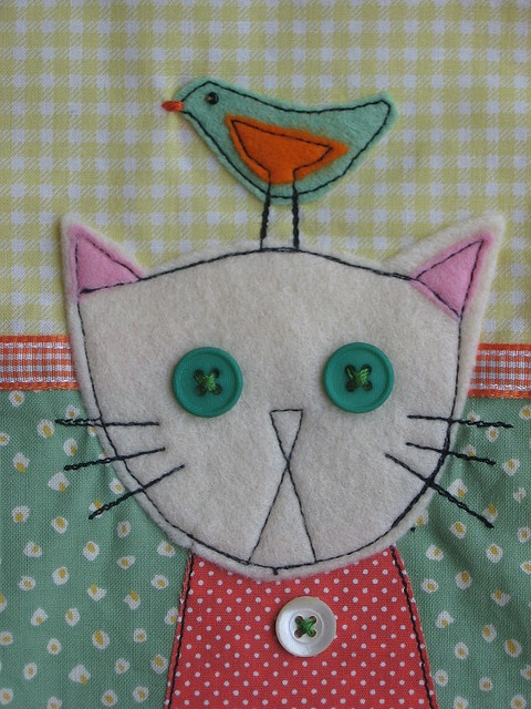 Close-up cat and bird applique   xx