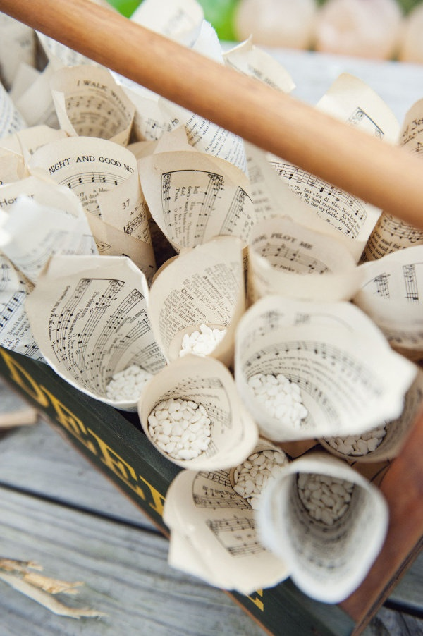 Music sheets used as cones for tossing rice at a #wedding