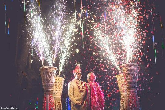 Them Jaimala moments be like this! Love this pyro and flower burst from the Jaimala pillars! Makes for such a photo opportunity <3 #IndianWedding #moments | curated by #WittyVows - The ultimate guide for the Indian Bride | www.wittyvows.com