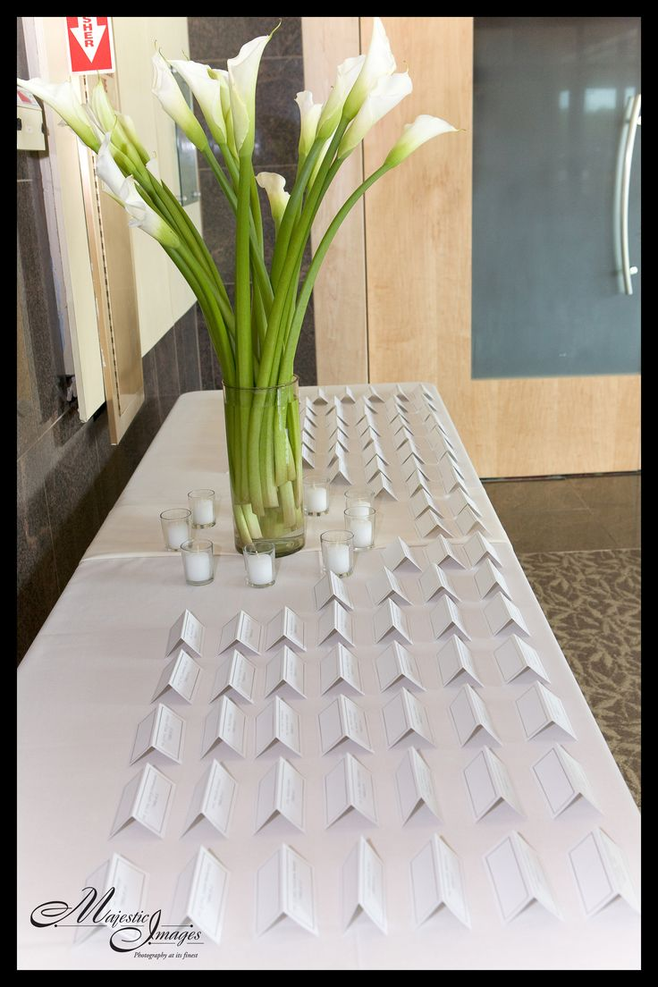 Opulent calla lilies for Rachel and Hal's escort card table at The Chase Center on the Riverfront.