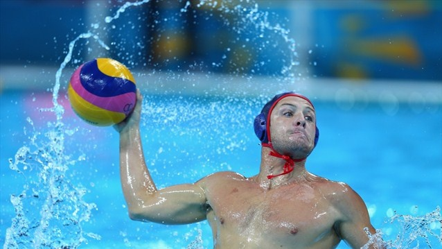 Anthony Azevedo of the United States competes during the men's Water Polo Preliminary Round match between Great Britain and the United States at the Water Polo Arena