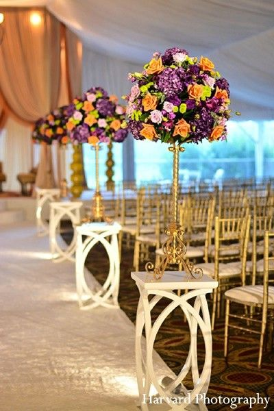 Use the reception table bouquets at the wedding ceremony