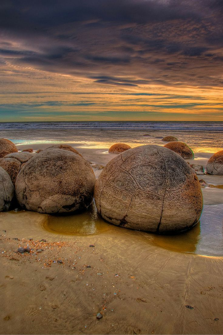 Sunrise on the The Moeraki Boulders on the Otago coast of New Zealand  | The Planet D Adventure Travel Blog