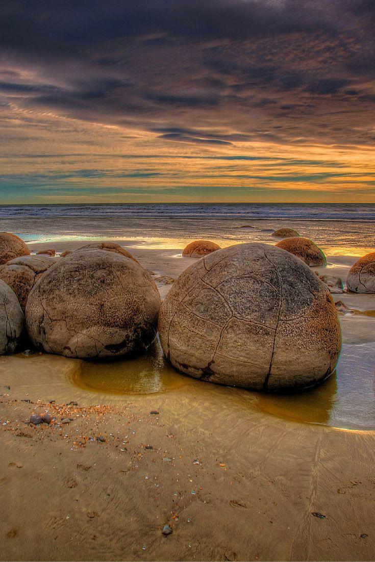 Sunrise on the The Moeraki Boulders on the Otago coast of New Zealand  | The Planet D Adventure Travel Blog