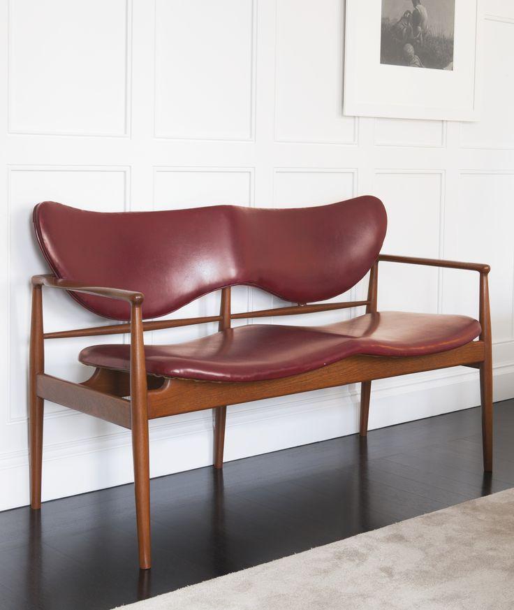 Finn Juhl; #NV 48 Teak, Brass and leather Settee for Niels Vodder, c1948.