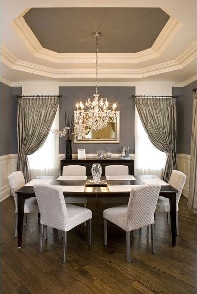 Gorgeous dining room...a little traditional and a little contemporary. Simple furniture; but look at how the chandelier and curtains bring elegance to the room. Our new home has a coffered ceiling like this and I love it!