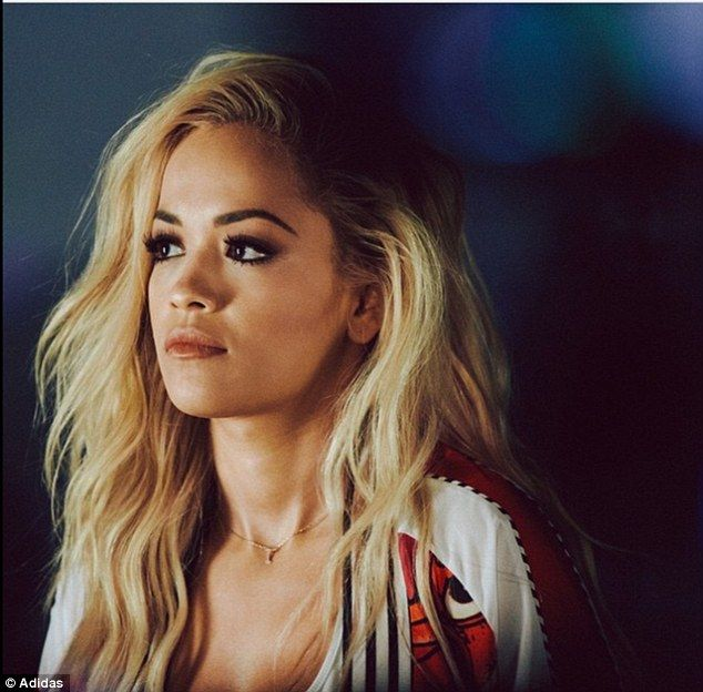 Looking good: With her blonde hair worn in a casual free-fall of curls, she also boasted i...
