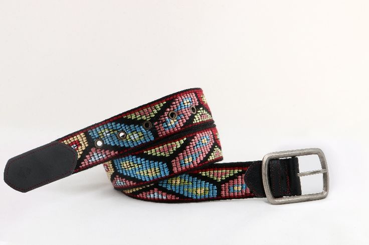 """Handmade woven belt created on wooden-manual loom. Pattern inspired of Thracian traditional outfit. Perhaps the most particular design from technique aspect, while during the embroidering number of ''pluntings"""" is demanded with many colors and various geometrical patterns."""