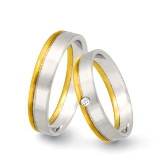 Coppia di fedi matrimoniali Flores Gioielli in oro bianco e giallo e un diamante per lei. € 814. ref F46  Wedding rings by Flores Gioielli