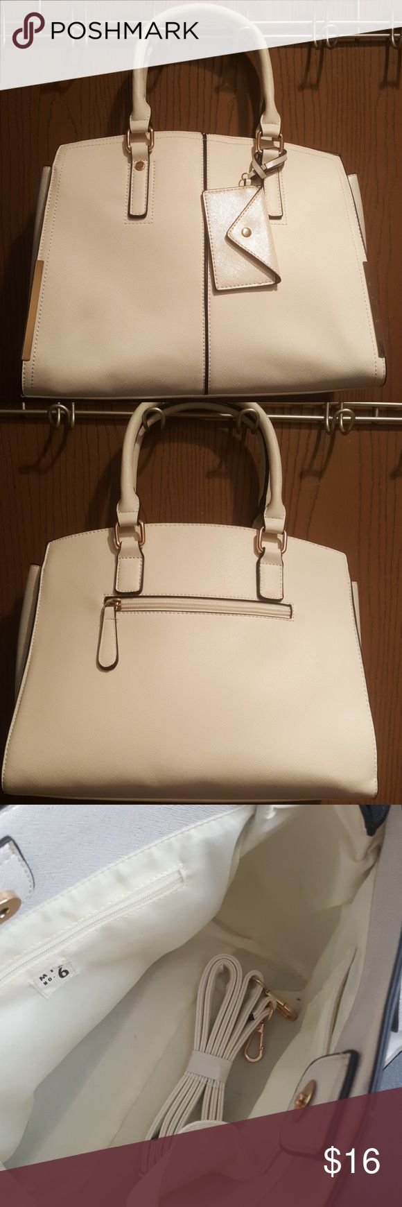 White gold medium sized bag Gently used white gold colored, bag with gold and black accents.  Comes with detachable small pouch and adjustable shoulder strap.  Inside and outside pockets! Mix No. 6 Bags Crossbody Bags