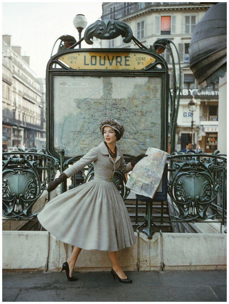 Robe Palais de glace, collection Haute Couture printemps-été 1957, ligne Libre -This image of a model wearing a gray Dior suit outside the Louvre Metro station was photographed by Mark Shaw in Par...