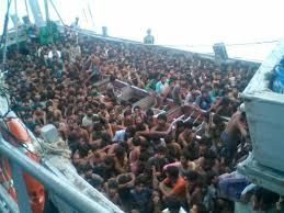 Rohingya crisis: Myanmar navy lands seized boat with 727 people on island.  The crisis worsens.