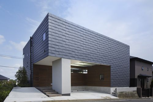 AY is a minimalist house located in Yokohama, Japan, designed by Hiroshi Yamagata Architects.