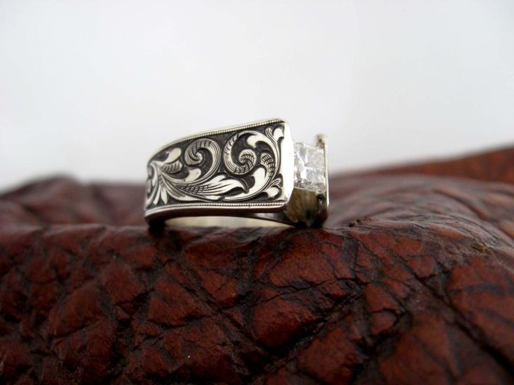 Custom made western wedding rings by Travis Stringer. Contact us on FaceBook. (Ring #75)