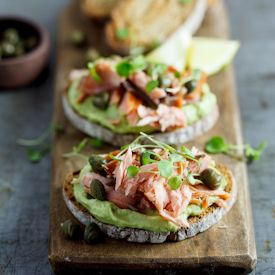 Rye toasts with creamed avocado and smoked trout. Open sandwiches for Food & Home