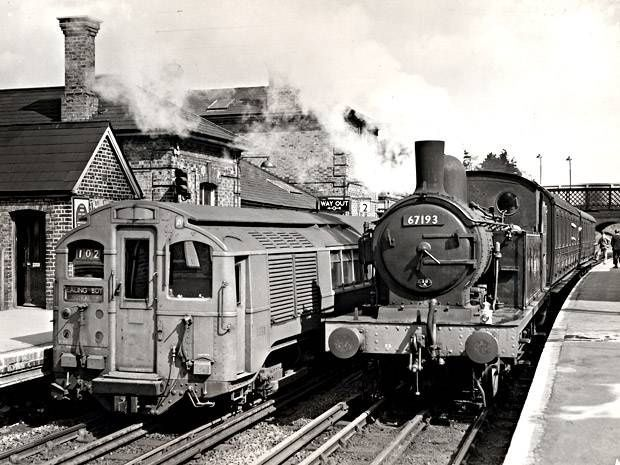 Steam and electric powered trains at Epping Station on the London Underground.