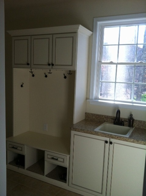 Here the laundry room doubles as a mud room!  And there's a sink for washing delicates or washing up from the outdoors!