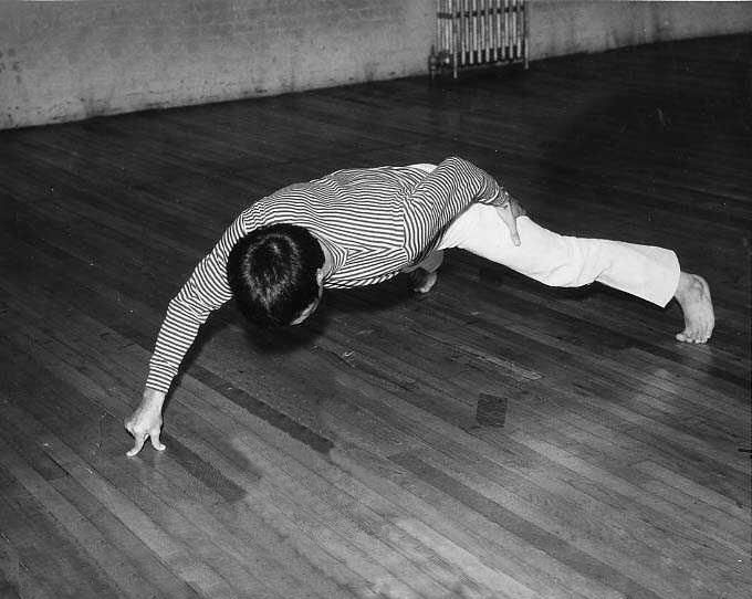 Bruce Lee... performing the only two fingered push up he was famous for!