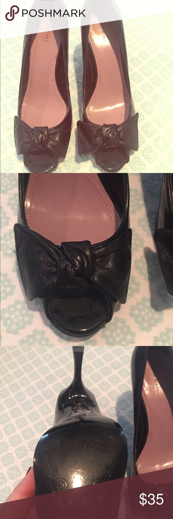 Tahari Black Leather Bow Peep Toe Heels 9 Adorable peep toe heels by Tahari with black leather bow - size 9.  Brand new never worn...look at the bottom!  I have too many shoes and am trying to downsize in my city apartment :) don't want to give them up but don't have the space. Tahari Shoes Heels