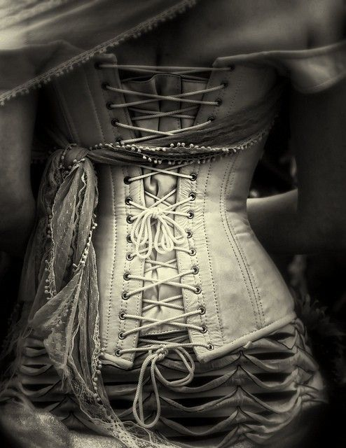 I love the texture, love the corset. The light and darkness of the photo is just wonderful.