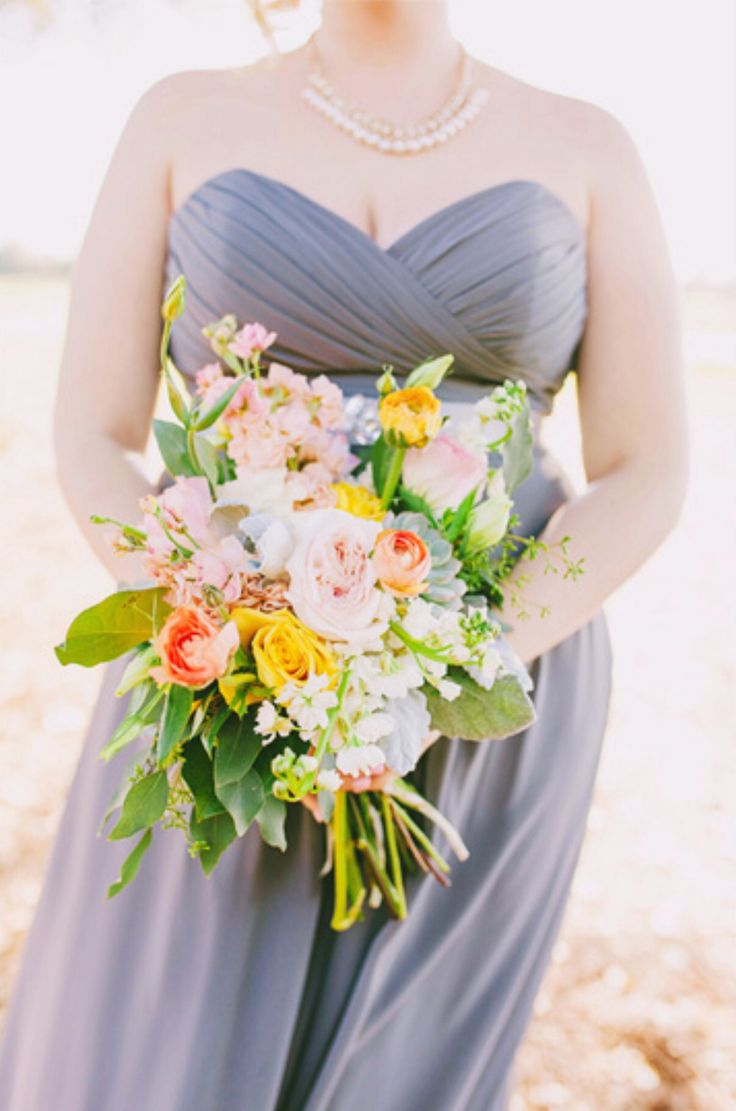 bridesmaid bouquet of Kiera garden roses, peach stock, white stock, peach ranunculus, vendela roses, light pink lisianthus, honey dijon roses, small mint green succulents, lemon leaf, dusty miller & seeded eucalyptus wrapped in cream satin ribbon