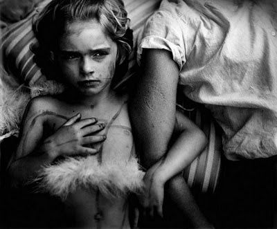 sally mann - the values and lighting especially. the expression. LOVE the skin on the arm. placement of arms. not wild about the striped thing behind her head. texture.