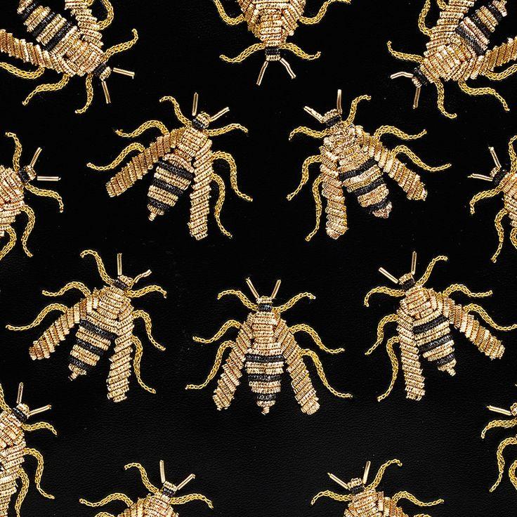 hand embroidered black wasps on vegan black leather