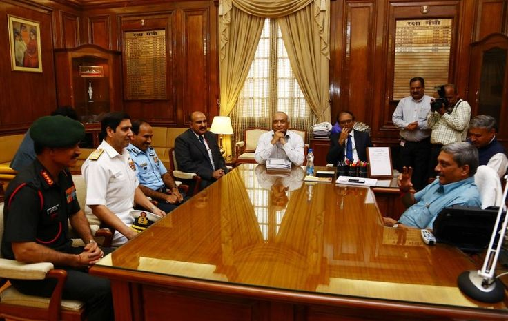 India's new Defence Minister Manohar Parrikar meets the three Service Chiefs at his office in South Block, New Delhi on Monday. ■ Photo: PIB