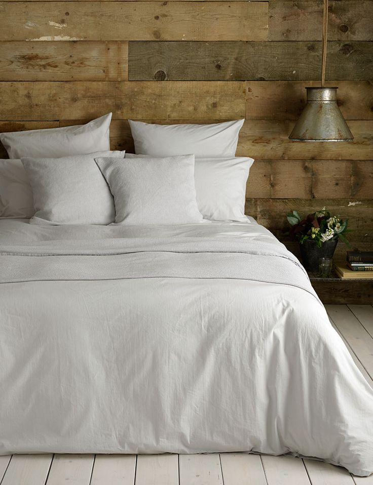 Discover our Washed Cotton Percale Light Grey Bedding Set. Simple, soft and slouched to perfection. We styled our grey sheets with rustic reclaimed wood and rustic metal accessories. The perfect set for superior slumber.