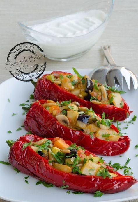 ✿ ❤ ♨ Kırmızı biber dolması tarifi / Malzemeler: 6 adet orta boy kırmızı biber. 1 adet kabak. 1 adet patlıcan. 1 adet patates. 1 adet havuç. 1 adet küçük soğan. 6 adet mantar. 3 çorba kaşığı kavrulmuş dolmalık fıstık. 3 adet domates. 2 çorba kaşığı sızma zeytinyağ. 1 tatlı kaşığı biber salçası. Sosu için: 2 su bardağı süzme yoğurt. 2 diş sarımsak. tuz. Kızartmak için sıvı yağ.(✿ ❤ biberleri daha hafif olması için teflon tavada pörpülemek(parpılamak) daha iyi olacaktır bana göre✿ ❤)