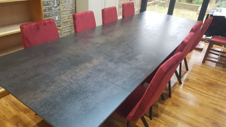 Contemporary dining set with the Xenon ceramic top extendable dining table and Candy dining chairs. Delivered to our client in London.