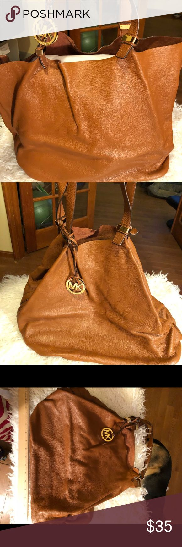 MICHAEL KORS LARGE SLOUCHY SOFT LEATHER TOTE LARGE MICHAEL KORS TOTE. Brass hardware and logo charm. Super soft camel colored glove leather. Open top. Twin long shoulder straps. Sides fold in for smaller loads. Michael Kors Bags Totes