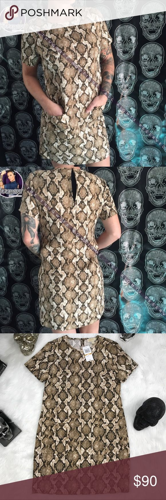 Michael Kors olive snake skin shift dress NEW WITH TAGS .     Beautiful shift dress with front pockets . Has button closure and keyhole oval opening at the back of the neck . Stunning light green / tan colored pattern. Two small pockets on front . Short sleeve . Python snake skin print casual dress .    💙 please use the offer button  🛍 BUNDLE FOR 10% OFF •   🚭smoke free  🌟 5 star rating   www.thethugwife.com 💀 @thethugwifeboutique             🚫 🙅🏻 N O   TRADES 🙅🏻 🚫 Michael Kors…