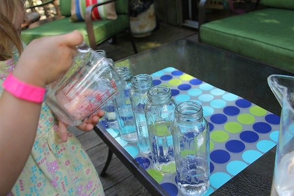 Add baby bottles to the water table.