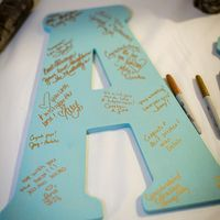 Cute Idea-large cutout initial for guests to write well wishes on-can be hung up in the house afterwards!