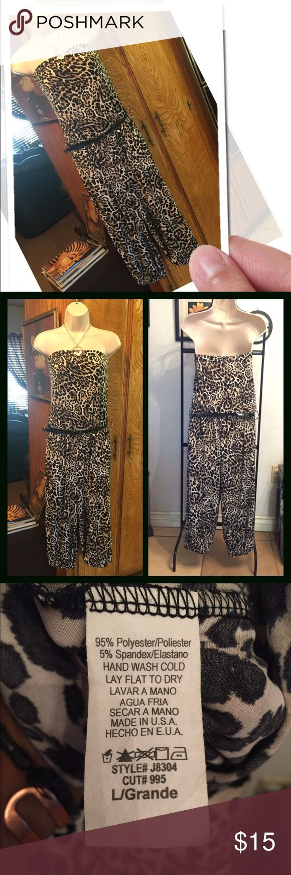 Cute animal print jumper nwot lg Very cute jumper pair with jacket, and some heels or ankle boots, and rock on. 95%polyester 5% spandex top 10 Pants Jumpsuits & Rompers