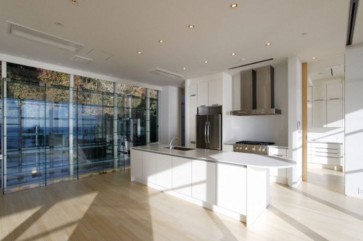 Architecture, Clean Kitchen With White Countertop And Kitchen Sink With Chrome Faucet With Built In Hood And Silver Refrigerator: Modern Villa Design Encompassing the Brightness and Airy Atmosphere