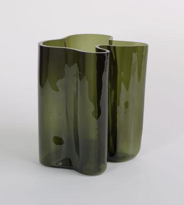 "Vase (3031)  Alvar Aalto (Finnish, 1898–1976)    1936. Mold-blown glass, 11 1/2 x 12 1/4 x 11 1/4"" (29.2 x 31.1 x 28.6 cm) (irreg.). Manufactured by Karhula-Iittala Glassworks, Iittala, Finland. Gift of Clarissa Alcock Bronfman"