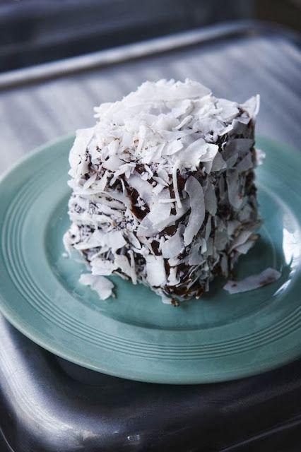 Lamington...an Australian dessert of sponge cake dipped in chocolate and coconut.