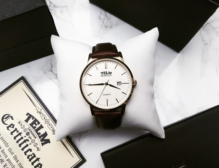 Stainless steel watch with brown strap by Telm London