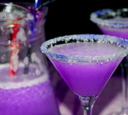 Bewitching Purple Martini -- 3 oz Vodka, 1 1/2 oz cranberry juice, ½ oz blue Curacao liqueur, ½ oz sweet and sour mix, ½ oz 7-up. Pour the ingredients into a cocktail shaker and shake gently. Add more blue Curacao if the color isn't purple enough. Serve in chilled glass. #cocktail #purple