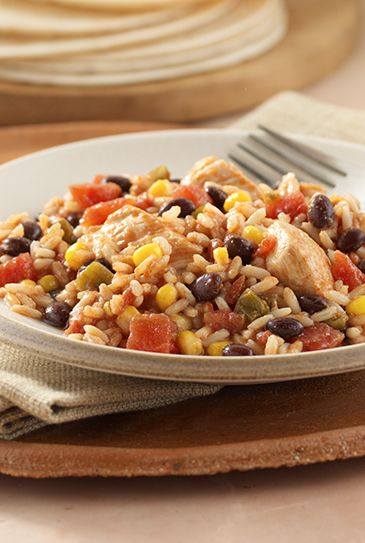 Rice and beans cooked with chicken and zesty tomatoes in a slow cooker for a no-fuss meal