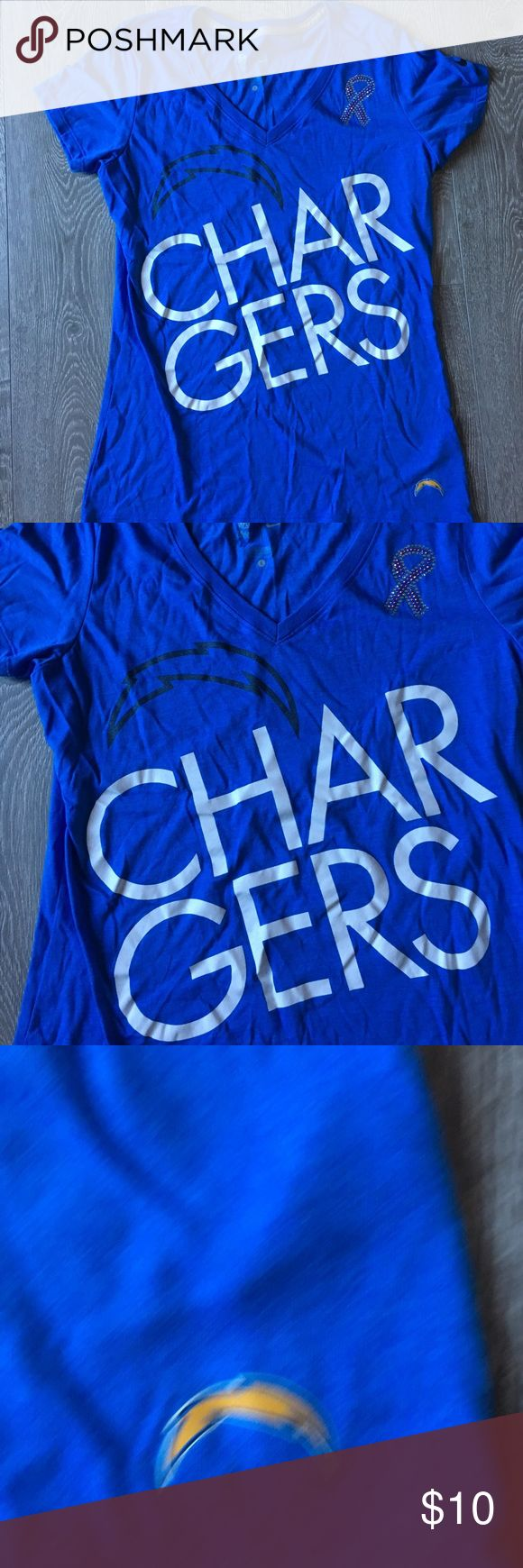 Ladies Chargers t-shirt. NFL. Los Angeles football fans . My loss is your gain. Brand new Chargers t-shirt. New never worn. Has BC awareness detail as well. NFL Tops Tees - Short Sleeve