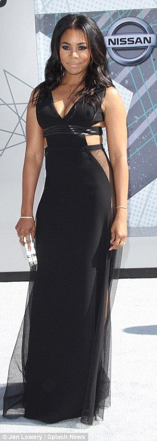 Beauties in black: Regina Hall wowed in a black cut-out gown andNaturi Naughton was racy in lace