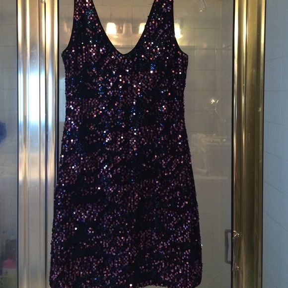 Sparkly Black dress Beautiful design only worn once all ornaments nice purple and blue intact in place nothing missing sexy dress perfect for a fun night out or wear with some tights and nice jacket city date! small but very stretchy can fit a medium because that's how I wore it nice and tight very well adjusted to show off your curves ! Dresses Mini