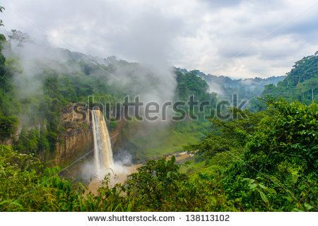 Water falls down out of the rock though the mist