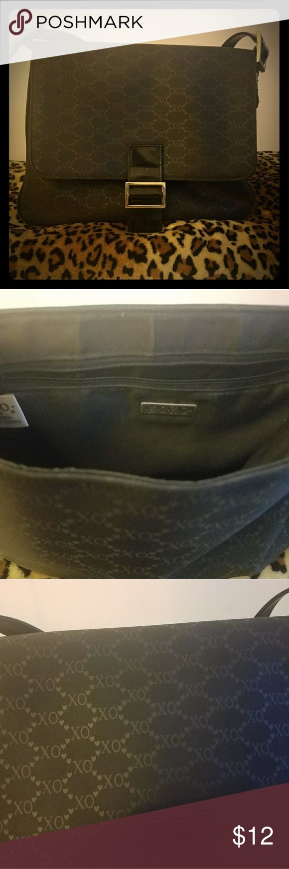 XOXO black handbag This handbag is gently used. You can see the usage on tbe silver buckles. It can be used for work, to go shopping, or to go out for fun. XOXO Bags