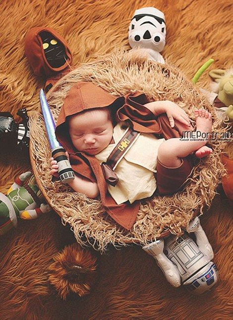 One baby has been dressed up as Luke Skywalker, with toy replicas of all the other Star Wa...