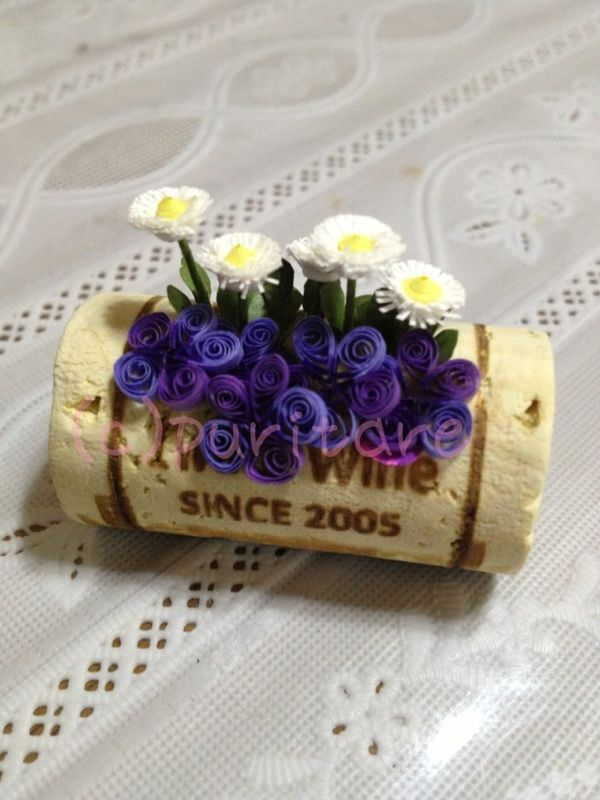 Put a magnet on the back you you've got a gorgeous quilling/cork project!